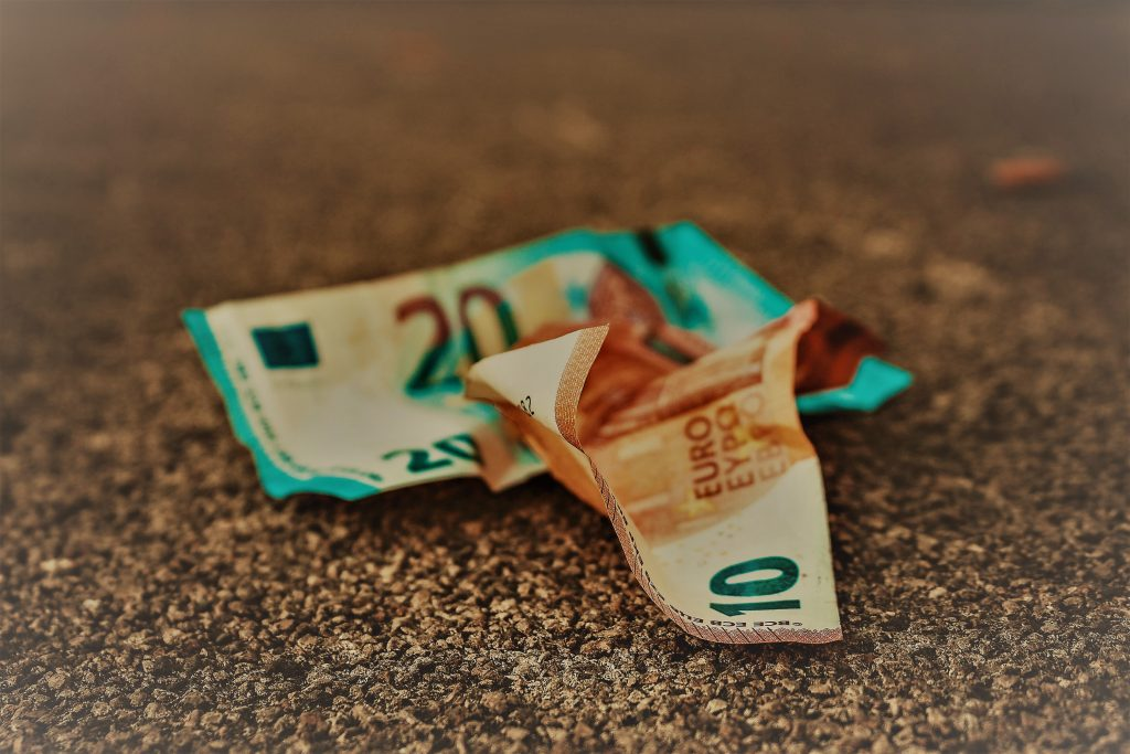 inflation-crumpled-bank-notes-on-ground