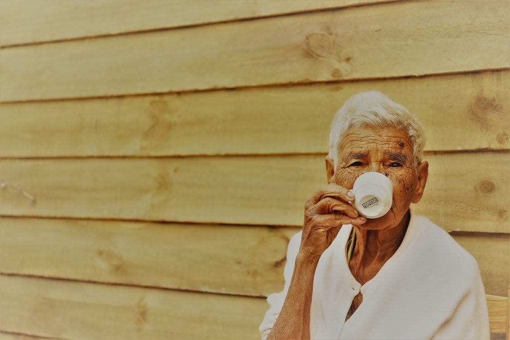 old-woman-drinking-from-white-teacup